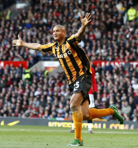 Hull City's Cousin celebrates after scoring during their English Premier League soccer match against Manchester United in Manchester
